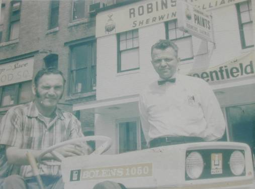 Mr. Norman Underwood and mechanic Douglas Gould when we were located on Main Street in Hudson